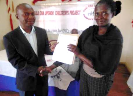 Sarah Lutta receives her cheque